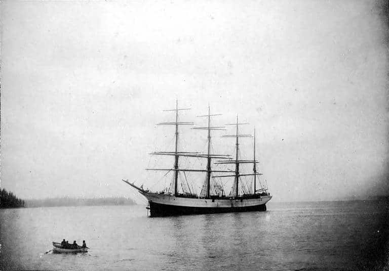 Four-masted_ship_PETER_IREDALE_at_anchor,_Washington,_ca_1900_(HESTER_634)